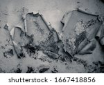 Small photo of Detail of a wall with degraded stucco. Wall in ruins. Degraded wall texture. Wall paint peeled by the action of time.