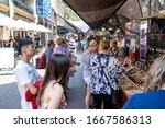 Small photo of Sydney, NSW Australia - December 07 2019: Tourists patronise the popular street market near The Rocks landmark.