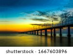 Small photo of Sunset river bridge sky clouds. RIver bridge sunset scene. Sunset river brisge landscape