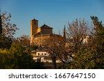 View to church of San Cristobal from Placeta Cristo de las Azuzenas viewpoint in the city of Granada, Spain