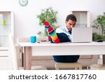 Young Male Businessman Working...