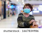 old asian woman in a mask for... | Shutterstock . vector #1667834986