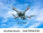 White Drone Quadcopter Taking...