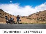 A Motorcycle Rider Takes A...