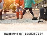 Workers Pouring Concrete With A ...