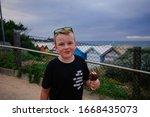 Boy Eating Ice Cream At...