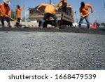 Blur Image  Repairing Pavement...