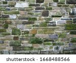 An Old Grey Stone Wall Made Of...