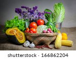 still life vegetable, variety kind of organic fresh vegetable display in wooden basket - stock photo