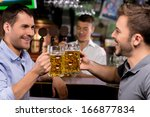cheers  two young men drinking...   Shutterstock . vector #166877834