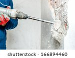 Man Using A Jackhammer To Dril...
