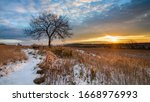 Dawn Over A Snowy Field With A...