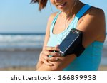 sporty woman touching phone... | Shutterstock . vector #166899938