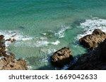 Waves Were Crashing On Rocks Of ...