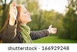 woman worshiping with open arms ... | Shutterstock . vector #166929248