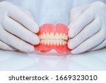 False Teeth Prosthesis. Doctor...