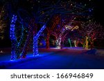 Snow Covered Pathway Decorated with Christmas Holiday Lights - stock photo