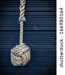 Nautical Knot On A Blue Wooden...