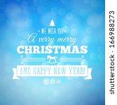 blue bokeh christmas background ... | Shutterstock .eps vector #166988273