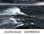 waves breaking and spraying at... | Shutterstock . vector #166988363