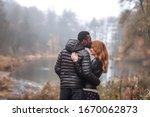 Interracial Couple Posing In...