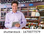 Portrait Of Wine Store Owner...