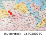 red clerical needle on a map of ...   Shutterstock . vector #1670200390