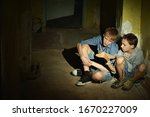 Portrait Of Sad Boys Sitting O...
