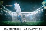 Small photo of Soccer scene at night match with player in a white and blue uniform kicking the penalty kick