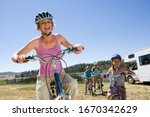 Family Riding Bikes In...