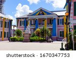 Small photo of Bahamas, 10/2019: beautiful city hall in the bahamas, colorfully decorated for the independence holidays with blue and yellow curtains, happy independence bahamas