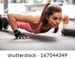 beautiful latin woman doing... | Shutterstock . vector #167044349