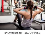 pretty brunette doing crunches... | Shutterstock . vector #167044463