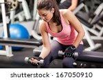 gorgeous brunette lifting some... | Shutterstock . vector #167050910