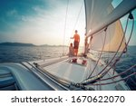 Young Couple Sailing In The...