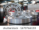 Small photo of Finished products made of closed and open type bearings. The concept of industry. General view of a large number of bearing