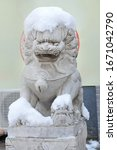 Chinese Stone Lion In The Snow