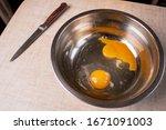 Broken Raw Egg Yolks In A Meta...