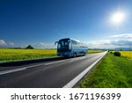 Blue Bus Driving On The Asphalt ...