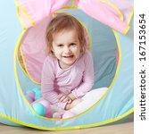 happy girl playing in her... | Shutterstock . vector #167153654