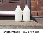 Small photo of Fresh semi skimmed milk in recyclable glass bottles delivered to the door by a traditional milk man in the UK
