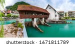Panoramic view of weir on Aare river of Old City of Unterseen, Interlaken, important tourist center in the Bernese Highlands, Switzerland