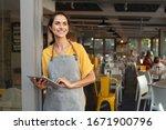 Portrait Of A Happy Waitress...