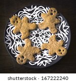 Small photo of Christmas Holiday Background with copy space and Christmas inger man cookies on a plate