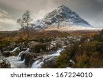 The mountain is Buachaille Etive Mor which rises above Rannoch Moor to a height of 1022m It is located in  Glencoe in the Lochaber region of Scotlands Highlands