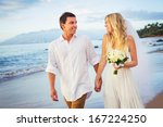 bride and groom  walking on a... | Shutterstock . vector #167224250