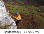 climber woman abseiling on... | Shutterstock . vector #167233799
