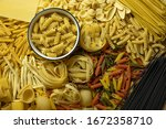different types of pasta lie on ... | Shutterstock . vector #1672358710