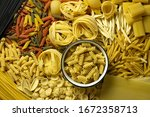 different types of pasta lie on ... | Shutterstock . vector #1672358713