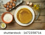 pancakes lie on a plate at... | Shutterstock . vector #1672358716